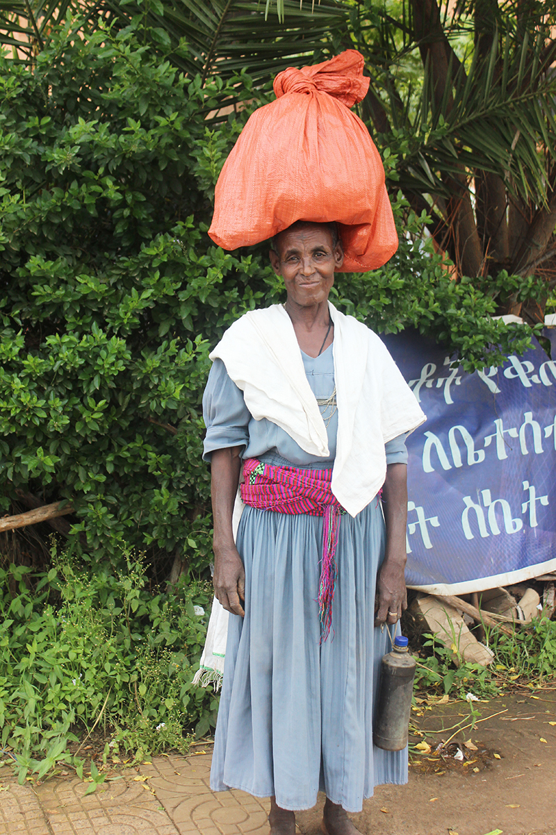 Ethiopian woman carrying a large bundle on her head